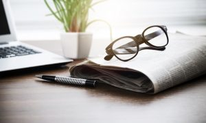 Newspaper, Glasses, and Laptop