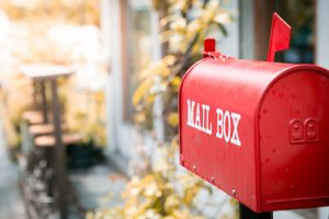 An image of a red mailbox